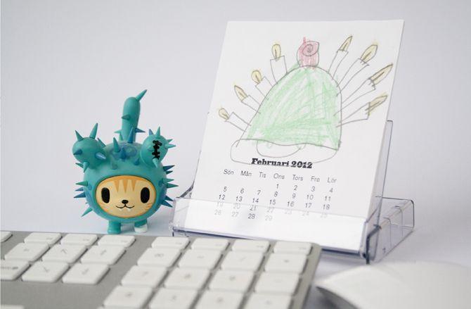 liten kalender i kassettfodral