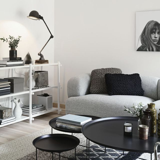 A very beautiful house- lovely grey couch, a modren looking black lamp, plants and a matching, round table set. And look at the pillows, too! //WHITE, WOOD AND GREYS IN STOCKHOLM