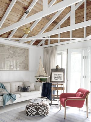 I like the natural tongue and groove ceiling with the white beams.