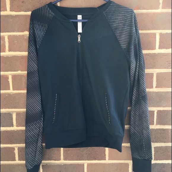 Under Armour Running and Yoga Jacket NWT Great brand new jacket from under Armour. Feel free to make an offer. Size medium. Perfect for spring. Under Armour Jackets & Coats