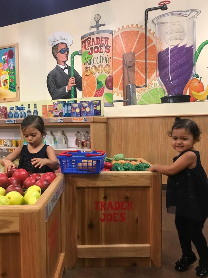 toddlers in trader joes at pretend city children's museum