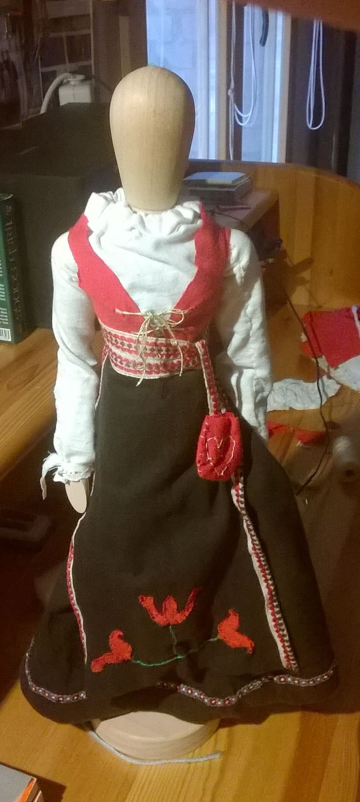 Norwegian bunad on a wooden doll by a Hungarian. A traditional (looking) dress that Norwegians wear anytime when they get the chance.