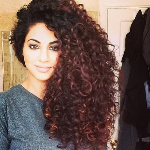 Annie Khalid (Pakistani pop star) // Does she not have the MOST GORGEOUS HAIR EVER? She swears by Coconut and Olive oil treatments daily (or at least twice weekly) and using cream based styling with a little olive (spiral curls) or coconut (corkscrew curls) oil added to it.  I'm officially on a Hair Journey now and want my curls to be as healthy as hers. Her hair is frizz-free, shiny, and most importantly healthy. WANT.