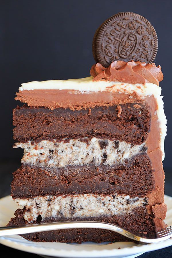The ULTIMATE Cookies and Cream Oreo Cake - A triple layer chocolate cake with cookies and cream filling, chocolate fudge frosting, white chocolate glaze and more Oreos on top! | www.browneyedbake...