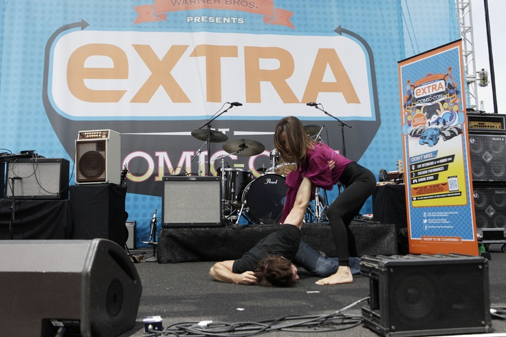 Anyone who's seen NIKITA knows its star Maggie Q won't stop until she gets the job done; here she continues the stunt demonstration with 87eleven's Sam Hargrave (on floor) at the EXTRA Stage at Comic-Con 2012 (© WBEI. All Rights Reserved.): Floors, Comiccon 2012, Stunts Demonstr, Comic Con 2012, Comic Comiccon, Nikita, Stars Maggie