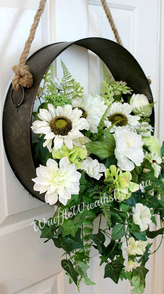 This Farmhouse Style Metal Silk Flower Wreath is so popular right now and would be perfect to add to your front door or to your Fixer Upper Style of decorating inside your home! I made this wreath with a metal circle and added lots of beautiful artificial flowers and greenery to fill it to overflowing! It has a rustic rope attached at the top for hanging.  This wreath measures approximately 17X35 from tip to tip so it will fit nicely wherever you choose to hang it. This would be the perfect…