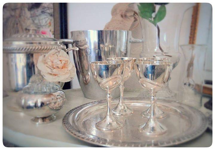 Pretty silver wine serving sets. In store.