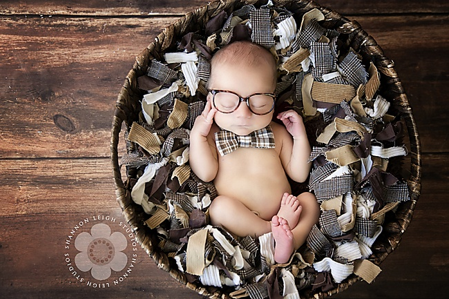 Cute geeky nerdy newborn pose with glasses and bowtie. So adorable in the basket. Nerd. Geek. Wood floor. Etsy. Dixie-Darlings » Newborn Contests & Etsy Giveaways featuring the cutest newborn photography in Memphis, Tn, The South, and The Entire United States