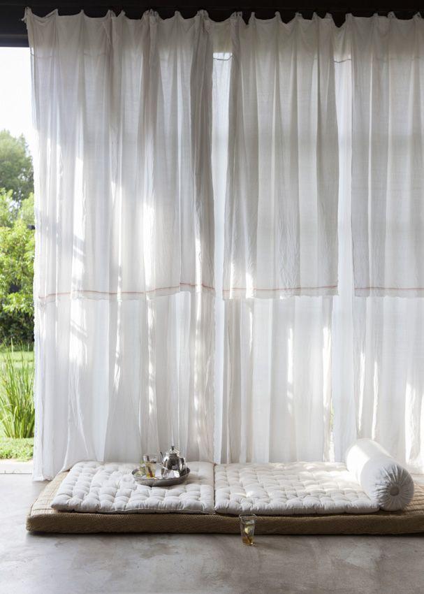 Tea time, white curtains, thin white mattress