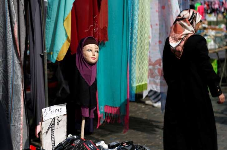 Companies may bar staff from wearing Islamic headscarves and other visible religious symbols under certain conditions, the European Union's top court ruled on Tuesday, setting off a storm of complaint from rights groups and religious leaders. In its first ruling on a hot political issue across Europe, the Court of Justice (ECJ) found a Belgian firm which had a rule barring employees who dealt with customers from wearing visible religious and political symbols may not have discriminated…