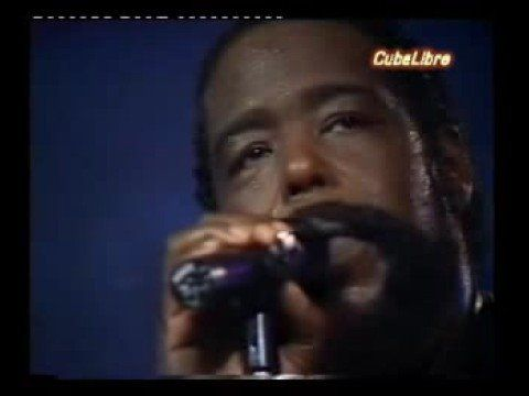 Barry White-Just the way You are.  Our first dance song...