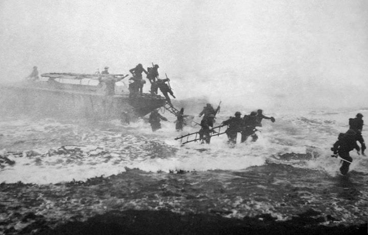 British Major Jack Churchill (far right) leads Commandos during a training exercise sword in hand in World War II.