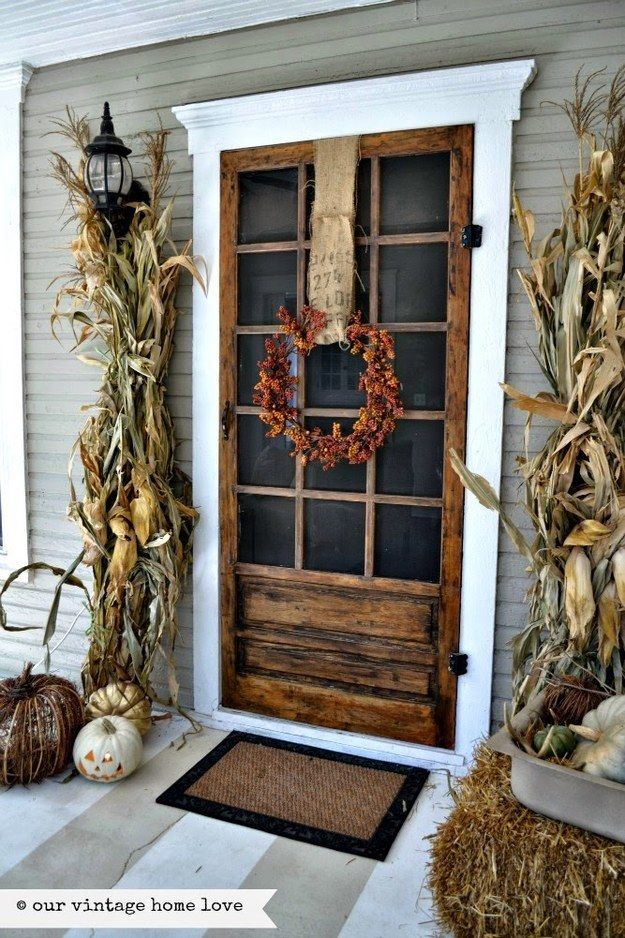 Create a rustic vibe with cornstalks and bales of hay. | 21 Fall Porch Ideas That Will Make Your Neighbors Insanely Jealous: