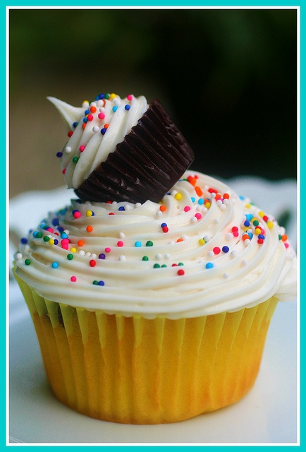 Delightful Mini Cupcake topped Cupcakes. Awesome party food for kids birthdays.