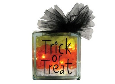Trick or Treat glass block. Created with lights, tissue paper, a vinyl saying and some tulle