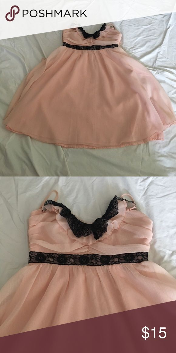 Candies beautiful dusty pink dress Chiffon layers and lined. Side zip closure. Black lace trip. Beautiful crisscross and rifle back. No trades Candie's Dresses