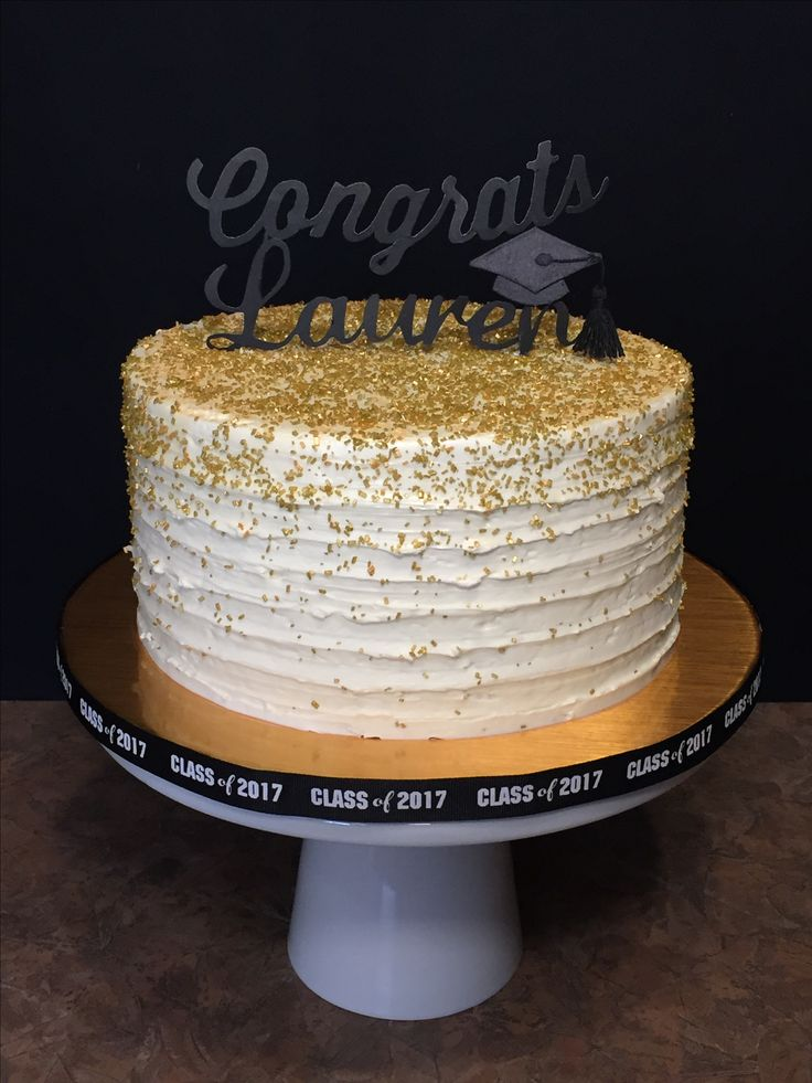 Lauren's Graduation Cake. White cake with dulce de leche filling and buttercream icing. Homemade cake topper.