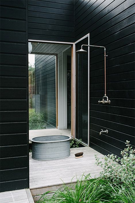 Outside shower with the collection tub to water the garden after. But I'd like a timber floor, and the water can then go on to the garden