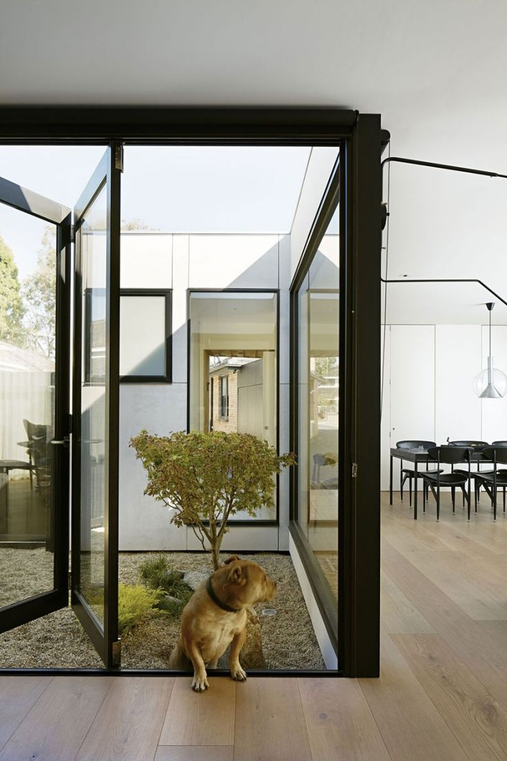 Paling Fence House by NASA | HomeDSGN, a daily source for inspiration and fresh ideas on interior design and home decoration.