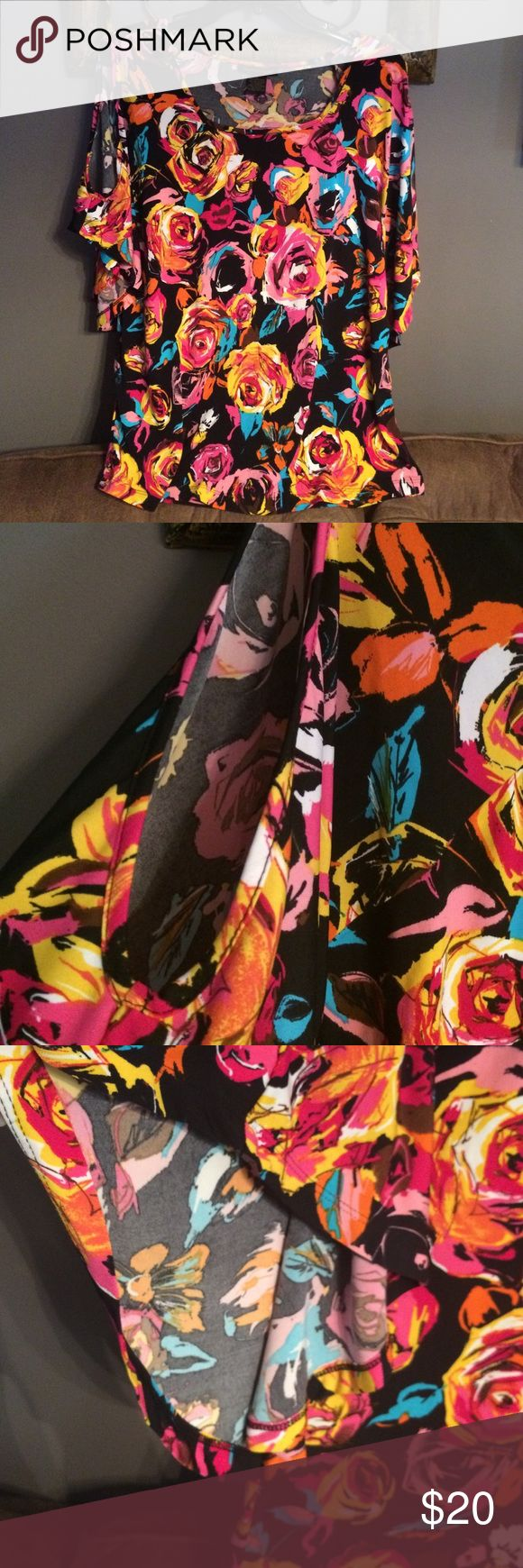 Susan Lawrence floral blouse This gorgeous blouse has batwing cold shoulder sleeves and a scoop neck. Soft and stretchy material so it's very comfortable! Oh and machine washable too!! EXCELLENT used condition! Susan Lawrence Tops Blouses