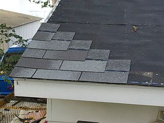 Row starter shingles nailed to the roof in stair-step fashion.
