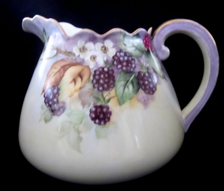 1918 Austrian Porcelain hand painted cider pitcher.  I had an aunt who used to paint porcelain.  This reminds me of her work.