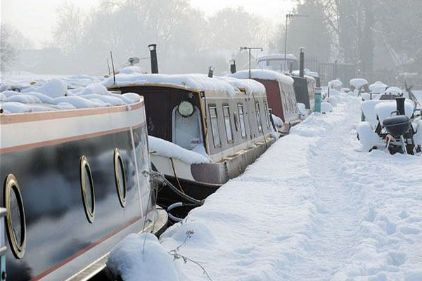 snowy canal boats