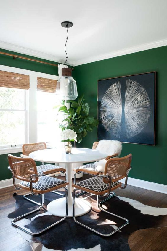 emerald green dining room - inspiration - window coverings for smaller window. ...need matching yellow print in valance here? Love the black and white animal skin on the floor.