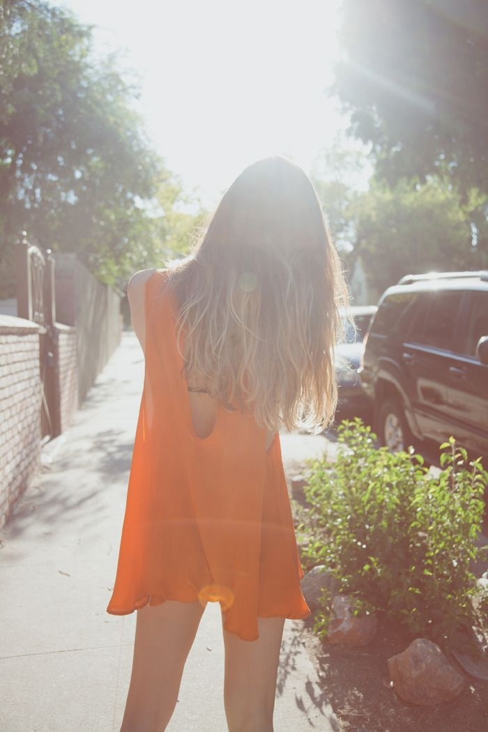 Love Rumi's choice of an orange playsuit on a hot day
