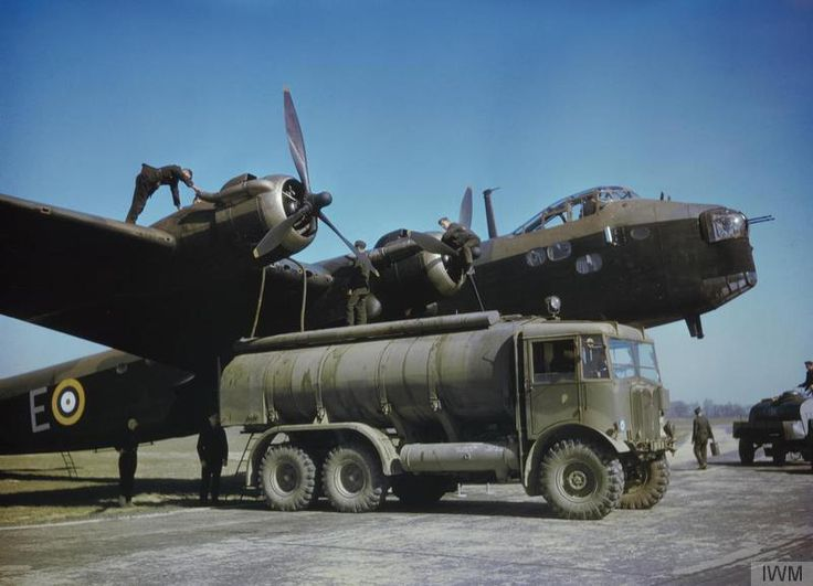 Groundcrew refuelling Short Stirling MK1, N1601 'E', of No.1651 Heavy Conversion Unit, from an AEC Matador 6x6 petrol tanker at Waterbeach, Cambridgeshire. 29th April 1942