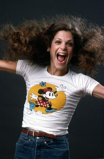 Gilda Radner (June 28, 1946 – May 20, 1989) was an American comedian, actress, and one of seven original cast members of the NBC sketch comedy show Saturday Night Live. In her routines, Radner specialized in broad and obnoxious parodies of television stereotypes, such as annoying advice specialists and news anchors.