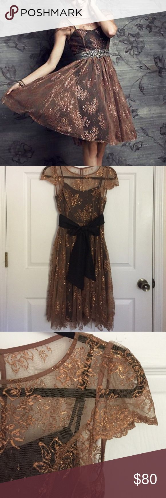 Anthropologie Gold Lace Dress Perfect condition! Bought this from another Posher but reselling because it's about half an inch too small across the chest. Fits perfectly everywhere else! (Mine does not come with the silver or black belt). Perfect anthropologie dress! Anthropologie Dresses Midi