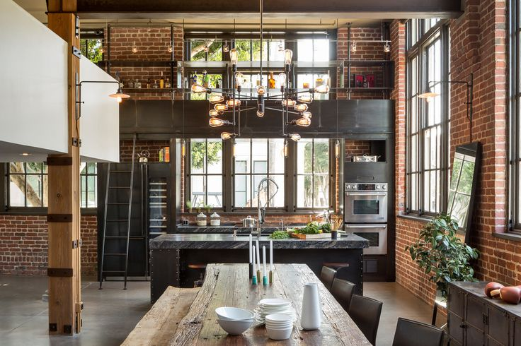 Floor To Ceiling Cabinets in Dining Room Industrial design. Brick walls with clocktower windows