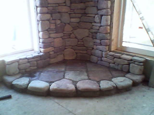 Stone hearth and backdrop for our next woodstove set up ...
