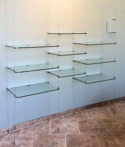 Glass shelves are suspended on 13 foot long cables
