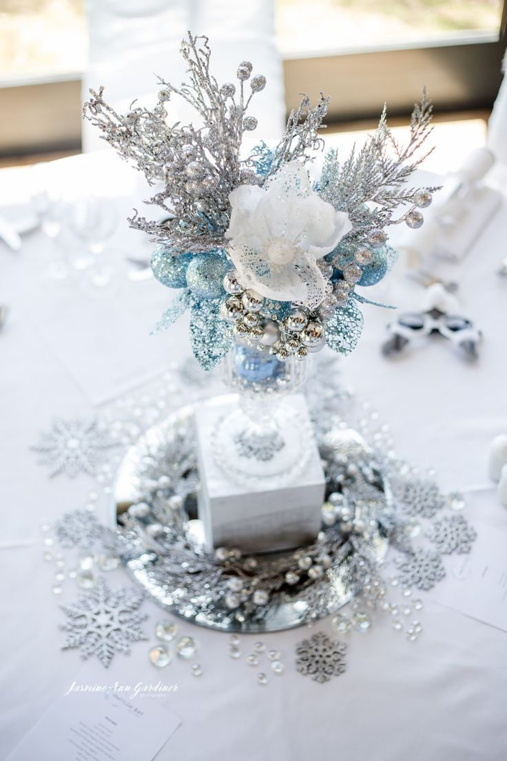 DY.o events (aka Duo) Winter wonderland corporate Christmas event. White, silver and blue table centrepieces.