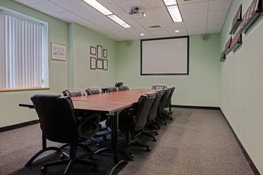 The conference room features a wireless projector and screen, Blu-ray DVD player, adjustable conference tables, Wifi and a wired Gigabit Ethernet LAN Connection.