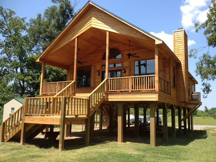 Live in a flood plain no problem build your house on Log cabin homes on stilts