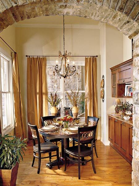 The Stone Arch Entrance Leads To A Cozy Breakfast Area Right Off Kitchen With Built In Walnut Hutch That Ties Two Rooms Together Perfectly