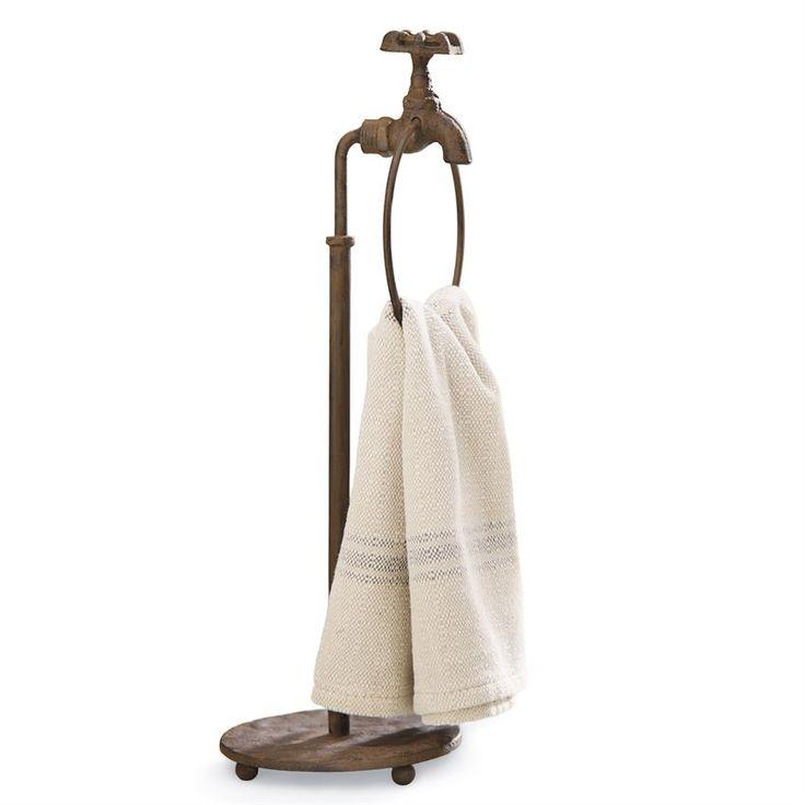 Standing cast iron towel holder features vintage faucet and spigot design.
