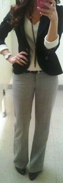Gray pants. White shirt. Long black necklace . Blazer. Work!