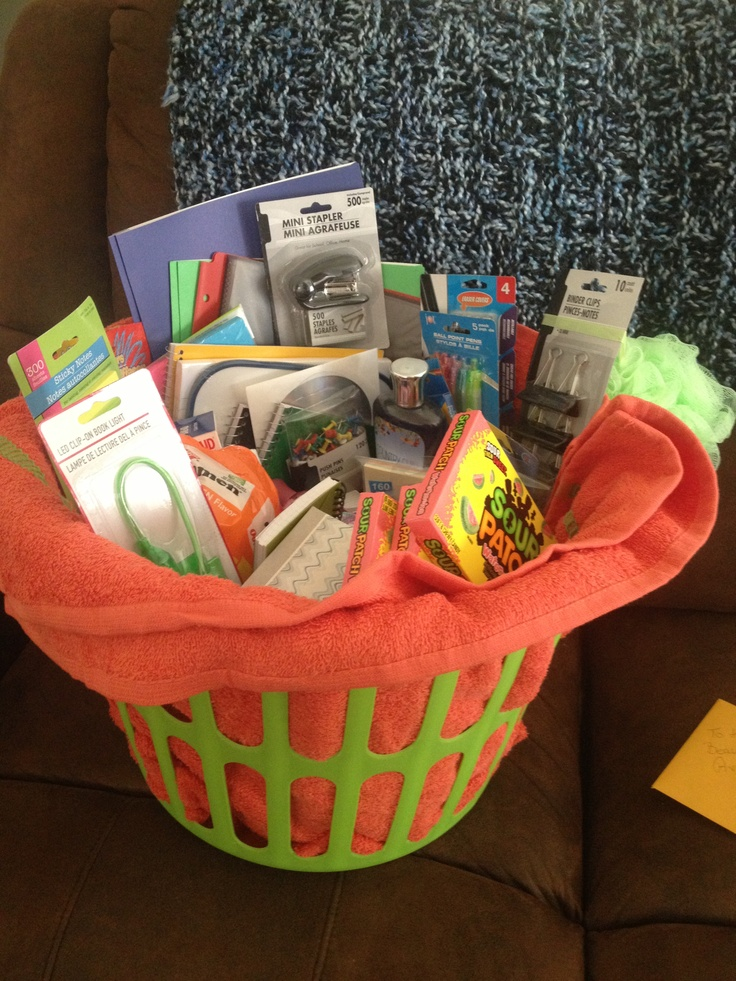 College survival kit! Towels, pain killers, school supplies, top ramen, and all other things they'd forget to bring. Awesome dollar store gift!