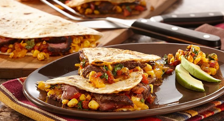 Stuck in a dinnertime rut? Serve quesadillas filled  with marinated steak, shredded cheese and a colorful salsa of lightly charred corn, bell pepper and onions.