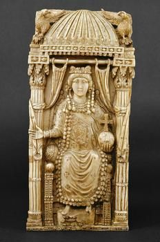 An ivory diptych, c AD 500, depicting the Byzantine Empress Ariadne; her imperial status is symbolised by her canopied throne, flanked by eagles; her cross-surmounted orb; and her crown. (Kunsthistorisches Museum Vienna)