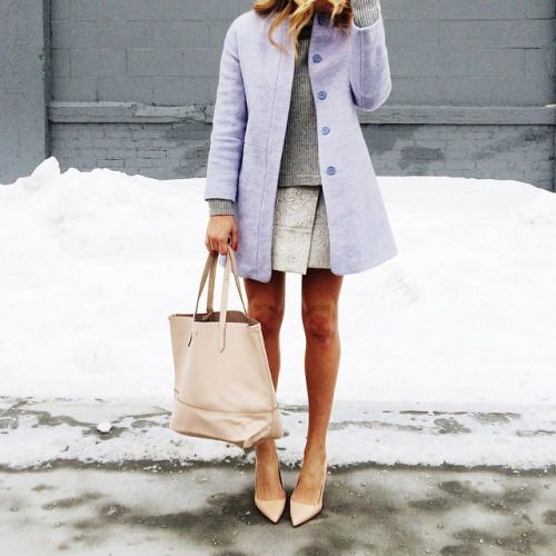 justthedesign:@laurenwells is wearing a lilac coat with a knitted ash grey sweater, paired with a creme handbag and heels