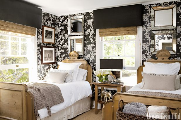 Love the black wallpaper balanced by the light of large windows and mirrors.