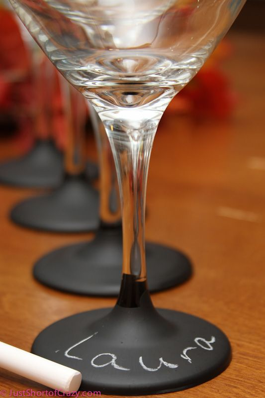 Wine glasses dipped in chalkboard paint! Cute idea.