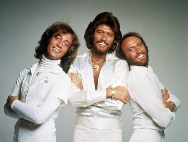 The BeeGees ... All white, turtlenecks under shirts, gold chains and bracelets, long hair, beards.