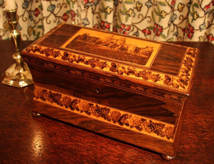 Victorian Tunbridge Ware Tea Caddy // A wonderful example of Tunbridge ware, in rosewood with elegant concave sides, standing on bun feet. With three bands of floral decoration and centre scene of Herstmonceux Castle in Sussex. Interior features two compartments with lids for storing tea, and a tea mixing bowl(replaced). // Price £1,500 //  - Maria Elena Garcia -  ► www.pinterest.com/megardel/ ◀︎