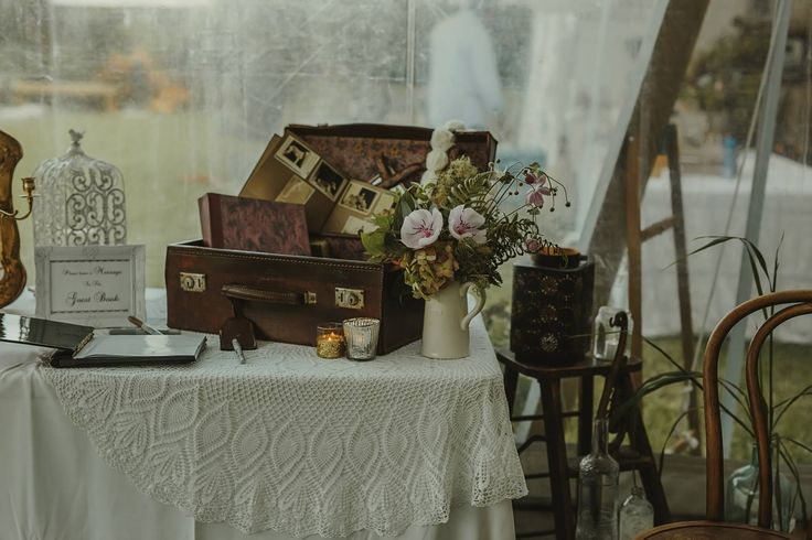 Guest Signing Book using Grandma's suitcase at a Boho Wedding in Liddington Gardens.  Styling by Susi Liddington Creative with the bride Delphine Atkins Photography Danelle Bohane